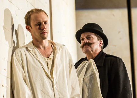 Johnny Herford as Josef K and Nicholas Folwell as Guard Willem [Photo: Clive Barda]