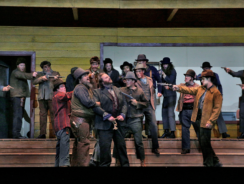 19 Gwyn Hughes Jones (Dick Johnson) and ensemble cast in 'The Girl of the Golden West' (c) Ken Howard for Santa Fe Opera, 2016.png