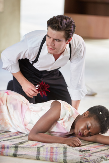 Oliver Johnstone as Puck and Joan Iyiola as Hermia [Photo by Mark Douet]