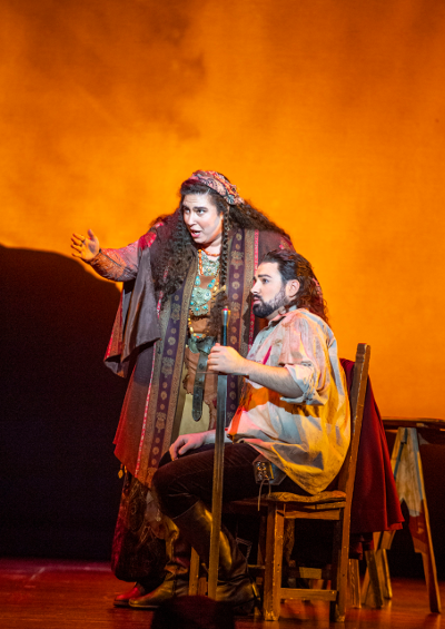 Azucena, (Daryl Freedman) describing to Manrico (Mackenzie Gotcher) her most tragic misdeed. [Photo by David Allen courtesy of Opera San José]