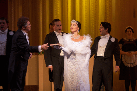 Corinne Winters is Violetta Valéry, flanked by the San Diego Opera Chorus [Photo by J. Katarzyna Woronowicz Johnson]