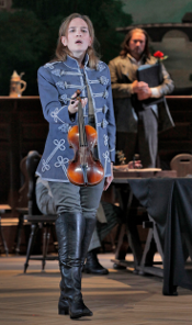 Kate Lindsey as Nicklausse with Paul Groves as Hoffmann in the background [Photo by Ken Howard courtesy of Santa Fe Opera]