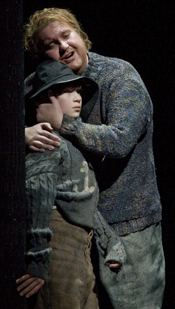 Logan William Erickson as the boy and Anthony Dean Griffey in the title role of Britten&srquo;s <em>Peter Grimes</em>. [Photo: Ken Howard]