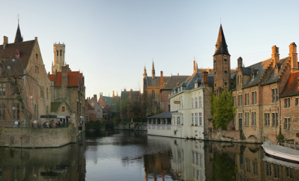 The Rozenhoedkaai [nl] (canal) in Bruges with the belfry in the background [Source: Wikipedia]