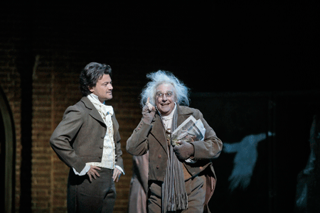 Vittorio Grigolo as Hoffmann and Christophe Mortagne as Frantz [Photo by Ken Howard / LA Opera]