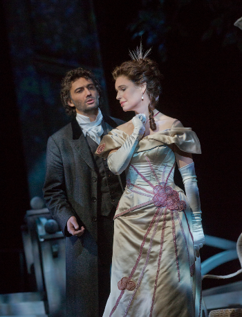 Jonas Kaufmann as the title character and Sophie Koch as Charlotte [Photo by Ken Howard/Metropolitan Opera]